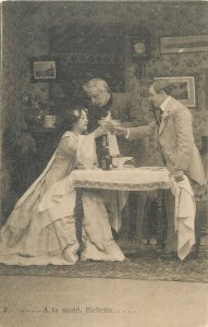 Postcard theatre man suit woman drink glass alchool table clock