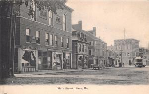 SACO MAINE~MAIN STREET STOREFRONTS~TROLLEY~H C LEIGHTON #20 PUBL POSTCARD 1900s