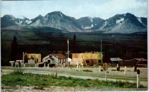 HAINES JUNCTION,   AK    View of VILLAGE, MOUNTAINS   c1950s  Roadside  Postcard