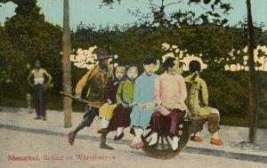 SHANGHAI ,  China , 00-10s ; Riding in a wheelbarrow