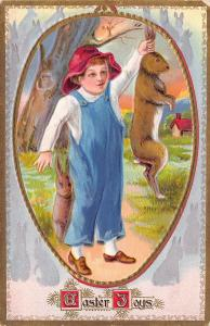 Easter~Farm Boy Holds Up Jack Rabbit By Ears~Bunny~Gold Emboss~Juvenile Series 8