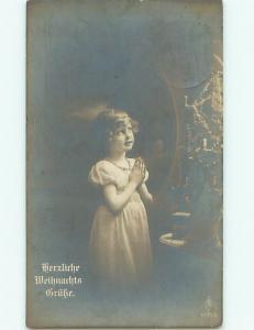 rppc 1919 GERMAN GIRL PRAYING BY THE CHRISTMAS TREE AC8271