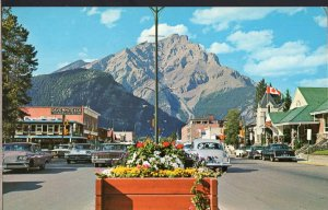 AB BANFF Main Street w/Cascade Mountain in background pm1969old cars 1950s-1970s