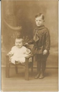 Little Boy with Baby Brother in little wooden chair in Sienna/Sepia Family Photo