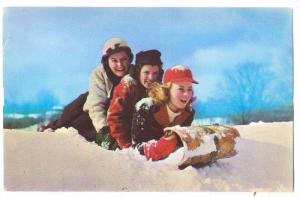 Three girls and a toboggan, 40-60s