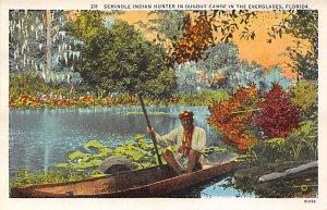 Seminole Indian hunter in dugout canoe Florida, USA Indian Unused