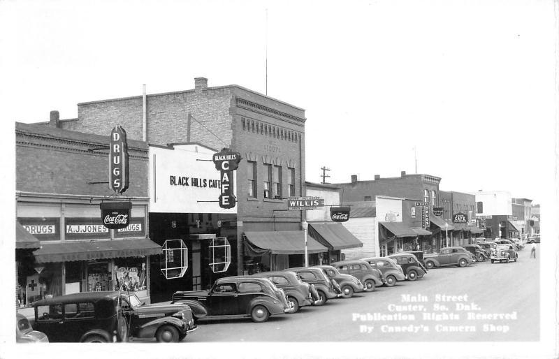 Custer SD~Main Street~Black Hills Cafe~Willis Dry Goods~Red Owl~1940s Cars~RPPC