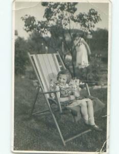 rppc 1940's Midcentury Modern NICE VIEW OF GIRL ON WOOD FRAME LAWN CHAIR AC8521