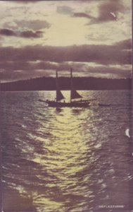 reflection of a 2-masted sailboat on the water, 1930s