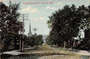 E76/ Lowell Ohio Postcard c1910 Saouth Walnut Street Homes Church