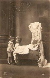 Little children. Baby in cradleMice old vintage Spanish postcard