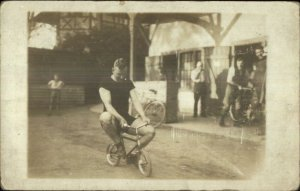 Unusual - Man Riding Tiny Bicycle Publ Leipzig Germany Real Photo Postcard