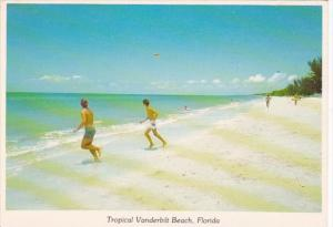 Florida Vanderbilt Beach Scene Playing Frisbee