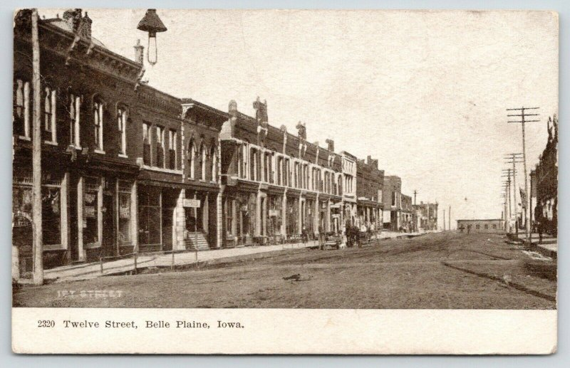 Belle Plaine IA~Hanging Light on Dirt Main (12th) St~Bldgs Mostly Gone~1907