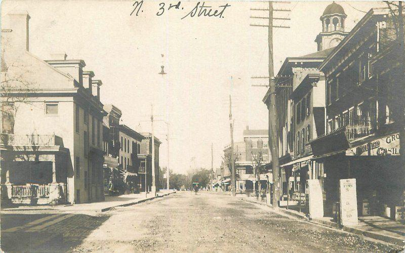 c1910 View N. 3rd Street United Grocery Barber Shop RPPC Real Photo