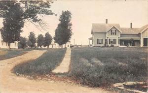 25148 ME, Thorndike, homes alongside dirt road