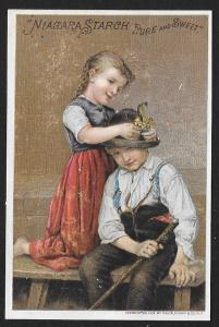 VICTORIAN TRADE CARD Niagara Starch Girl Putting Flowers in Boys Hat c1871s