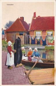 Netherlands Volendam Canal Scene Ladies In Row Boat