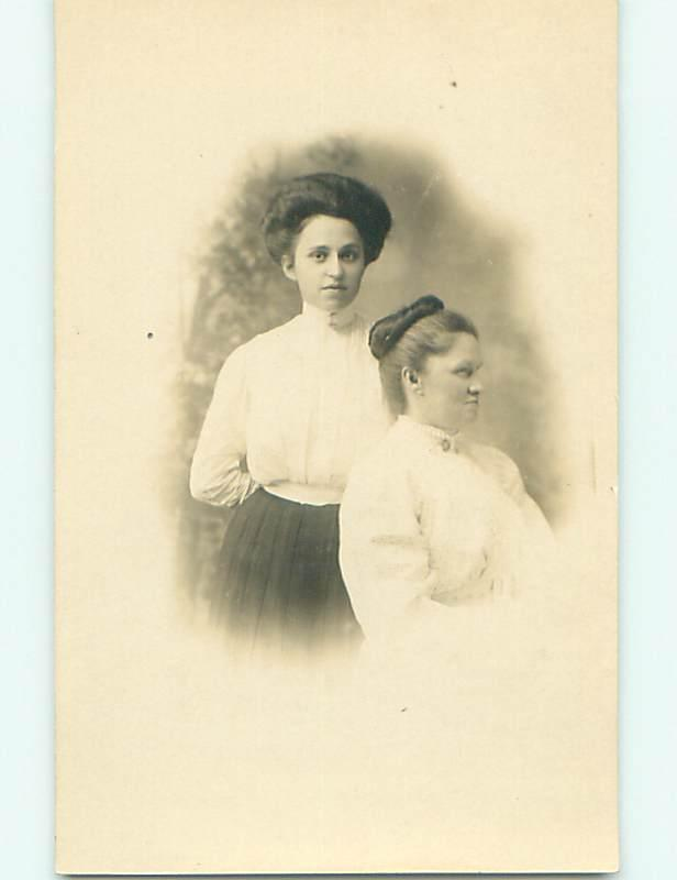 Pre-1918 rppc TWO WOMEN WITH ONE TURNED TO THE SIDE r5847