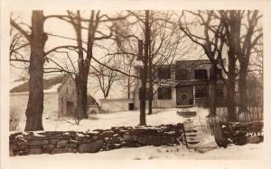 25429 NH, House and garage behind rock wall