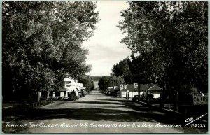 TEN SLEEP, Wyoming RPPC Postcard Main Street Scene / Gas Signs SANBORN Photo