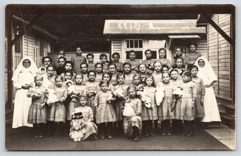 RPPC~Catholic Nuns~Girls Parochial School~At Least 11 Big & Little Dollys~c1910