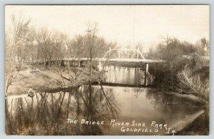 Goldfield Iowa~Riverside Park Bridge~Picnic Table on Boone River~Boat~1908 RPPC