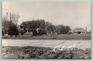 Sterling Colorado~NJC Junior College Campus~Roadside Sign~House~1940s RPPC