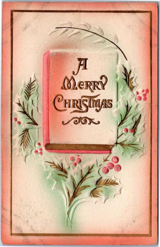 A Merry Christmas embossed book with holly