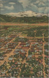 1982 Aerial view of downtown Co. springs with pikes peak in the BG Vtg Postcard
