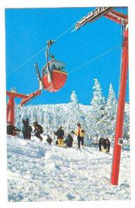 Skiers preparing for the decent on top of Mt. Mansfield, Stowe, The ski capit...