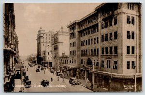 Johannesburg ZA~Commissioner Street~Hughes Gents Outfitters~1920s Cars~RPPC