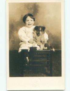 Pre-1918 rppc BOY HUGS DOG Embossed As Wallace By Osburn & Pinehurst ID i9330