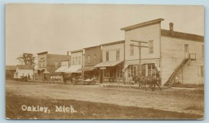 Postcard MI Oakley Michigan c1912 Main Street View Stores RPPC Real Photo AD12