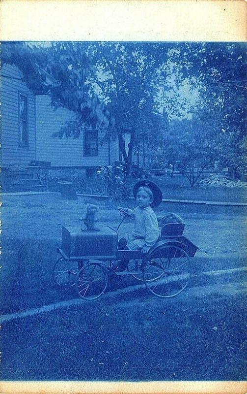 Young Child with Pedal Car Cyan Type Real Photo Postcard