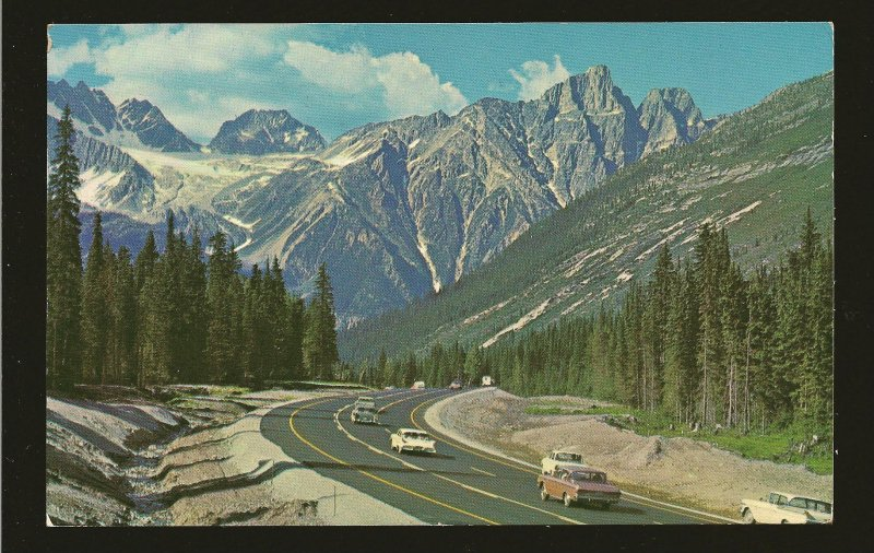 Postmarked 1963 Salmon Arm BC Rogers Pass Rocky Mountains with Cars Postcard