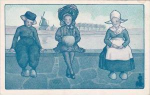 Dutch Children Sitting On Seawall The Walk Over Shoe