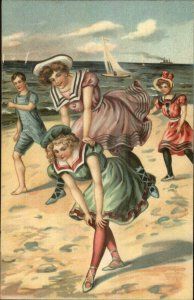 Bathing Beauty Women Playing Leapfrog on Beach c1910 Embossed Postcard