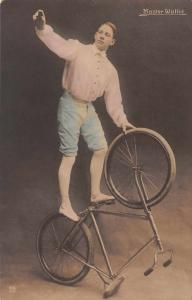 Master Wallie Man on Bicycle Tinted Real Photo Antique Postcard J79433