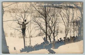 Rushford MI~Crowd Watches Ski Jumper High in Air~Ladies w/Merry Widow Hats RPPC