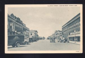 SIDNEY NEBRASKA DOWNTOWN ILLINOIS STREET SCENE OLD CARS VINTAGE POSTCARD