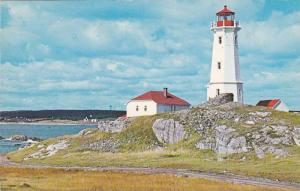 The Lighthouse at Louisbourg Harbour, Cape Breton, Nova Scotia, Canada, PU-1971