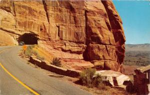 GRAND JUNCTION COL CAR  EXITS TUNNEL~FRUITA CANYON~RIM ROCK DR POSTCARD 1960