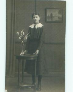 rppc 1920's GIRL STANDING AT ANTIQUE WOODEN STAND AC8548