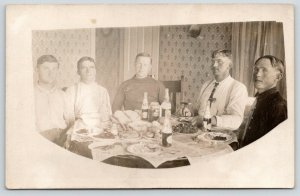 RPPC Five Men Feast Around Table Drinking Velvet Beer From Bottles~c1910