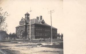 Cheboygan Michigan~Dirt Road by Central School~Man @ Flag? Pole 1906 UDB RPPC