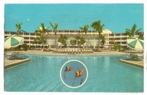 Pool side View, Couple swimming, Holiday Inn, Grand Bahama Island, PU-