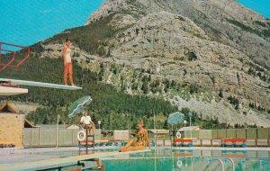WATERTON LAKES, Alberta, 1940s-Present; Waterton Lakes Swimming Pool And Moun...