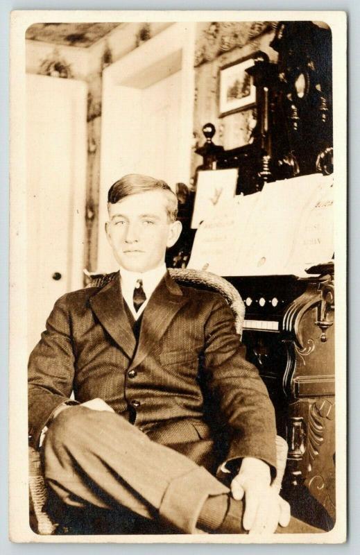 RPPC~Young Man Sits at Tall Art Nouveau? Pump Organ w/Legs Crossed~RPPC c1910 PC