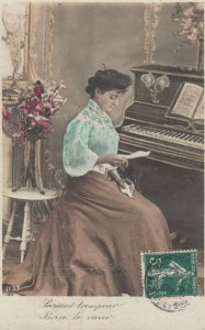 RP: Woman reading a letter at Piano , 00-10s